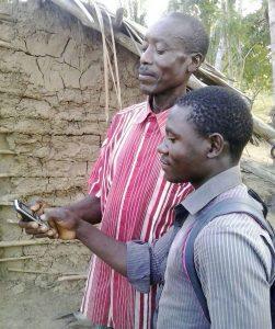 A farmer receiving an SMS